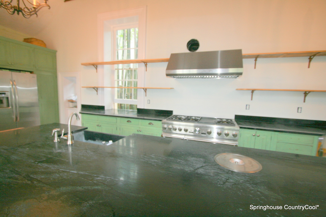 springhouse soapstone island and kitchen with reclaimed pine and cypress
